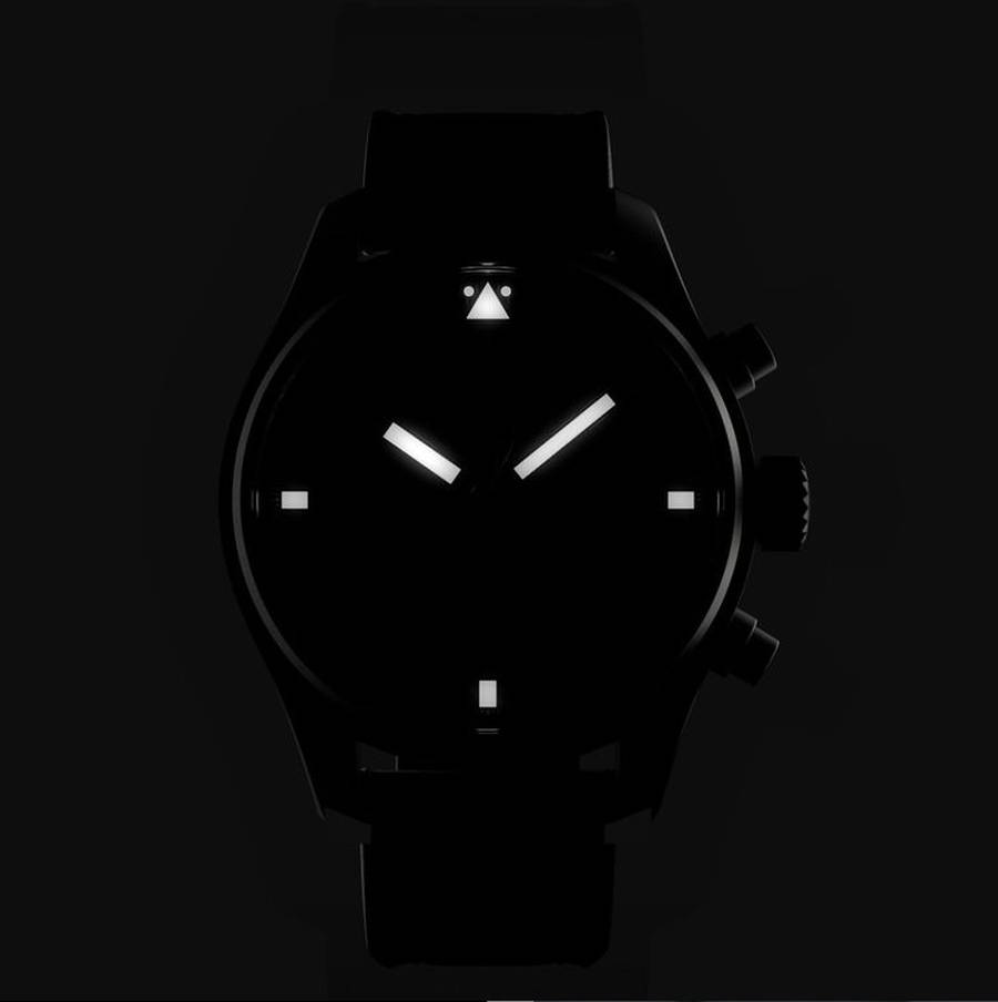 A picture containing black, watch, dark  Description automatically generated