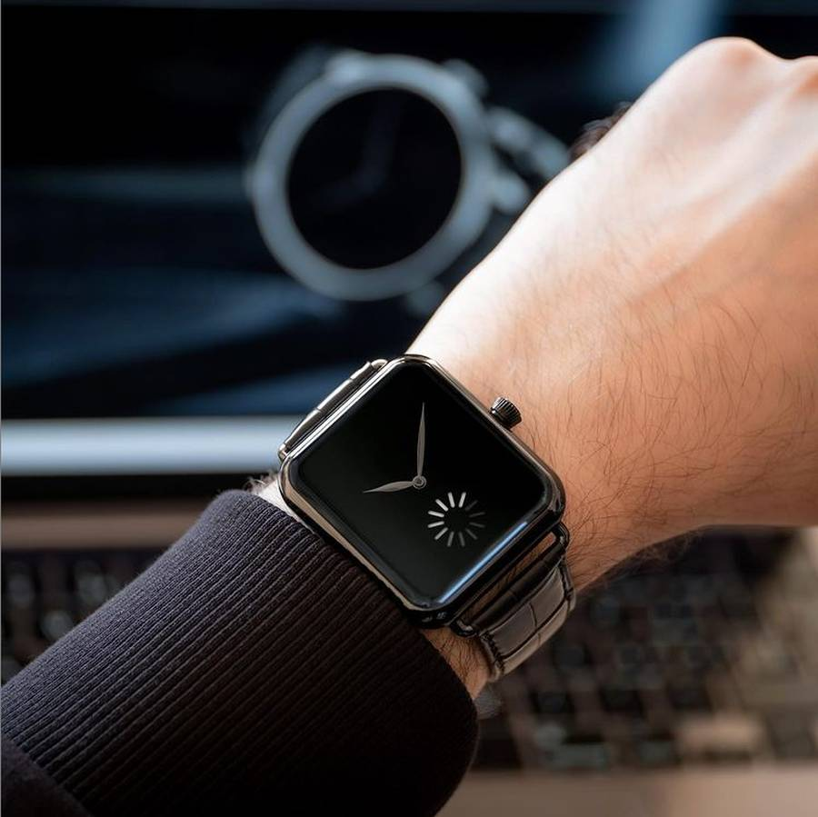 A person holding a watch  Description automatically generated with medium confidence