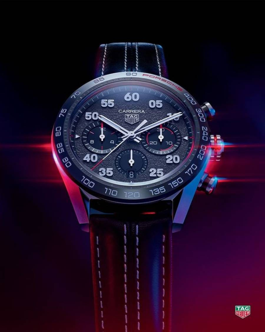 A black watch on a stand  Description automatically generated with low confidence