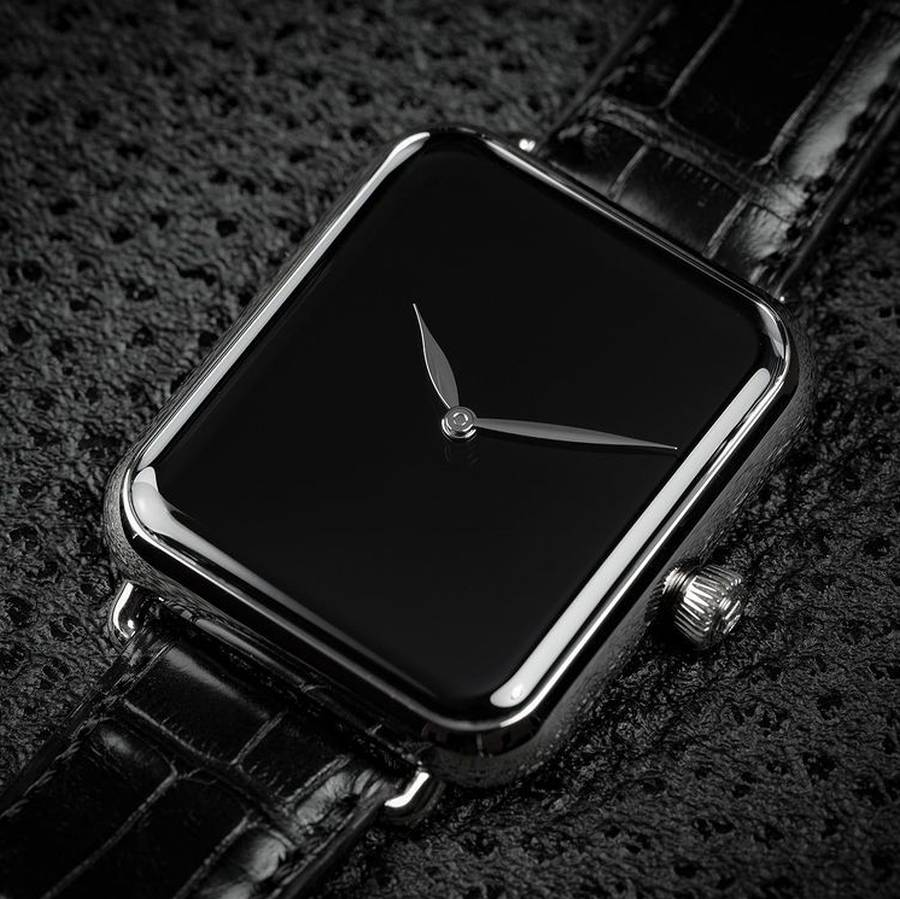 A picture containing cellphone, black, watch, accessory  Description automatically generated