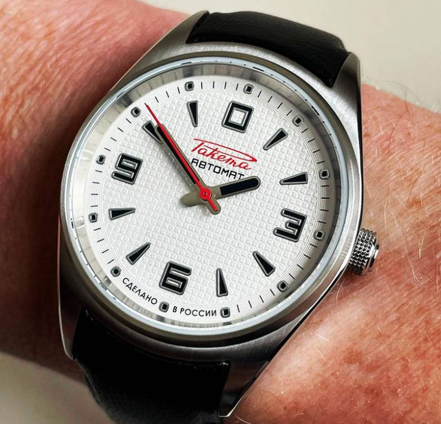 A wristwatch on a person's wrist Description automatically generated with low confidence