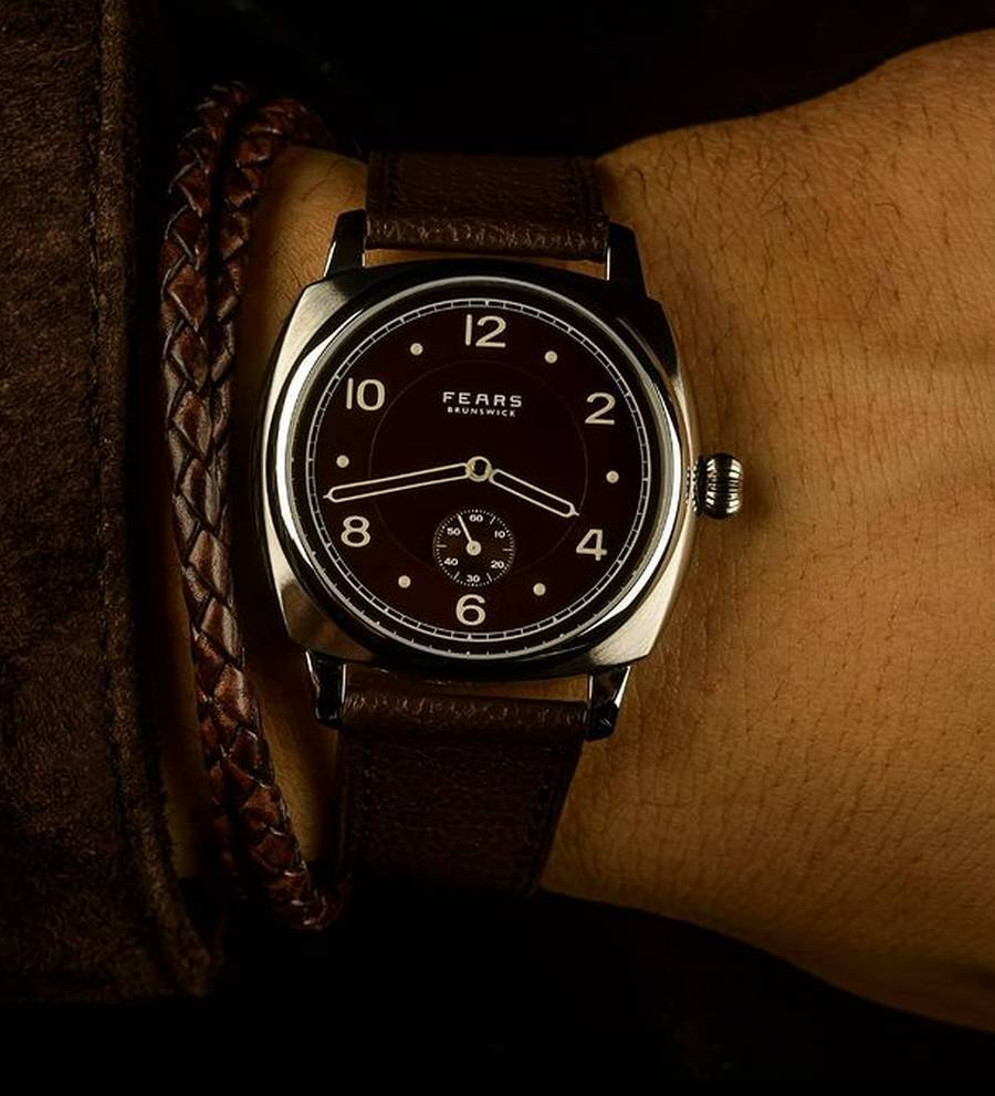 A black watch on a wrist Description automatically generated with low confidence