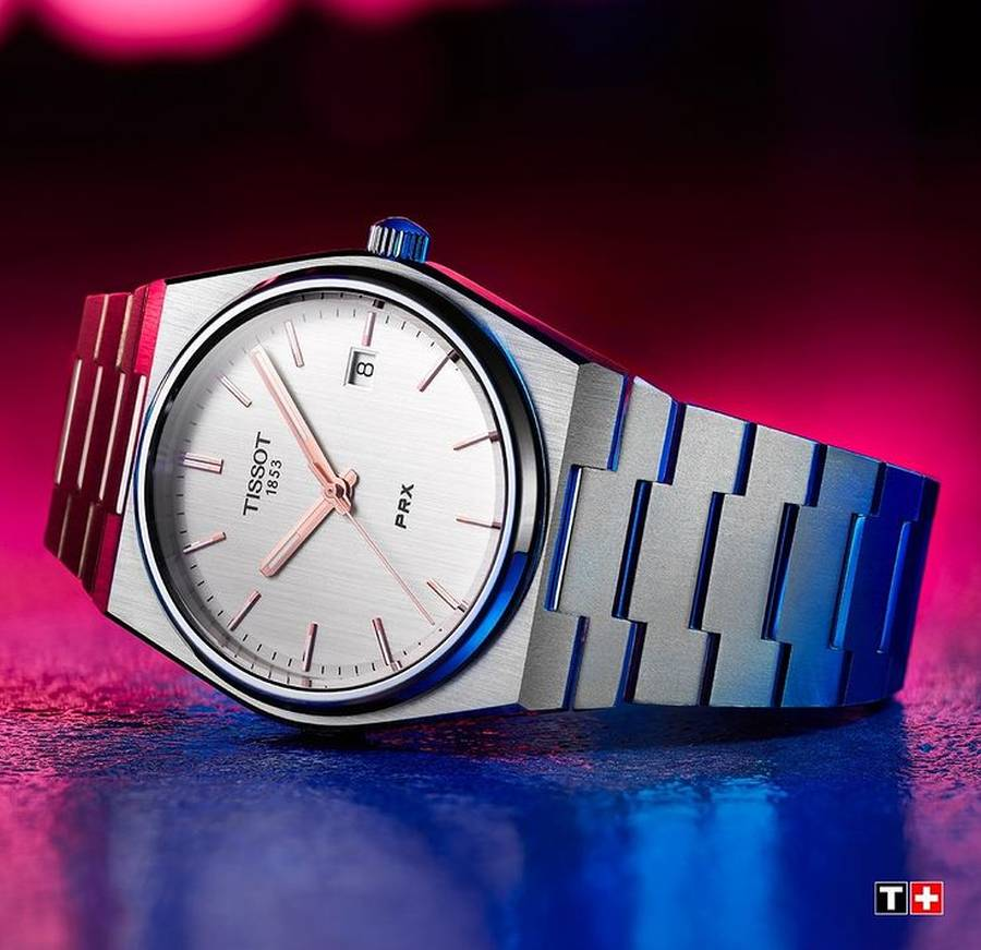 A picture containing text, indoor, red, watch Description automatically generated