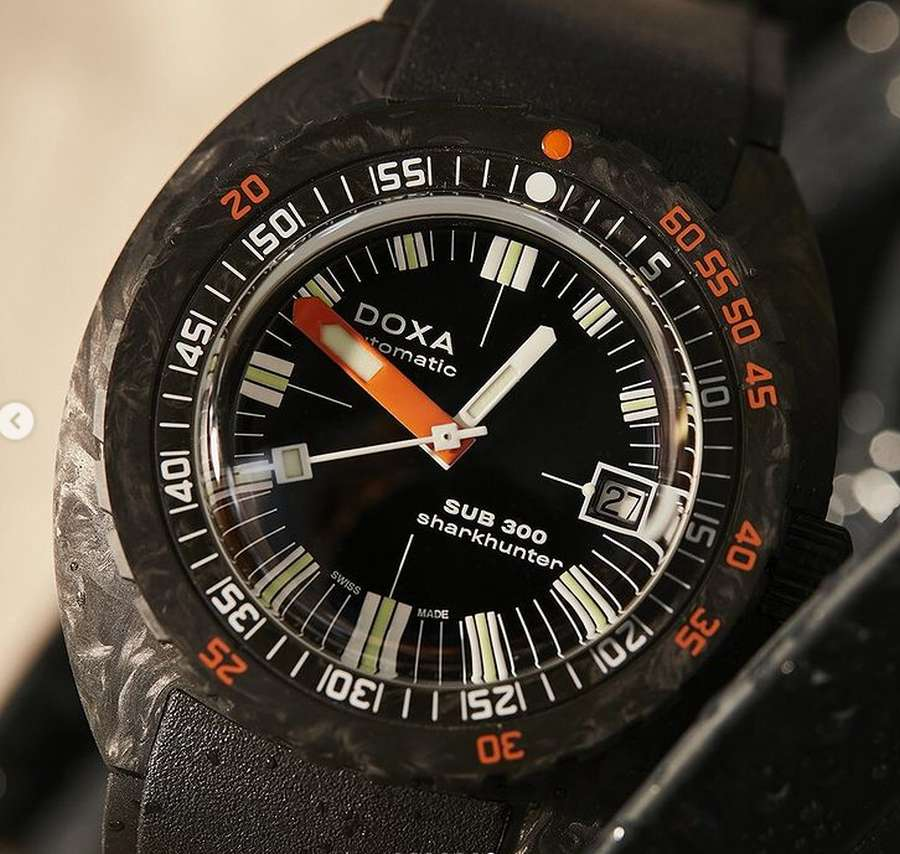 A picture containing black, indoor, watch  Description automatically generated