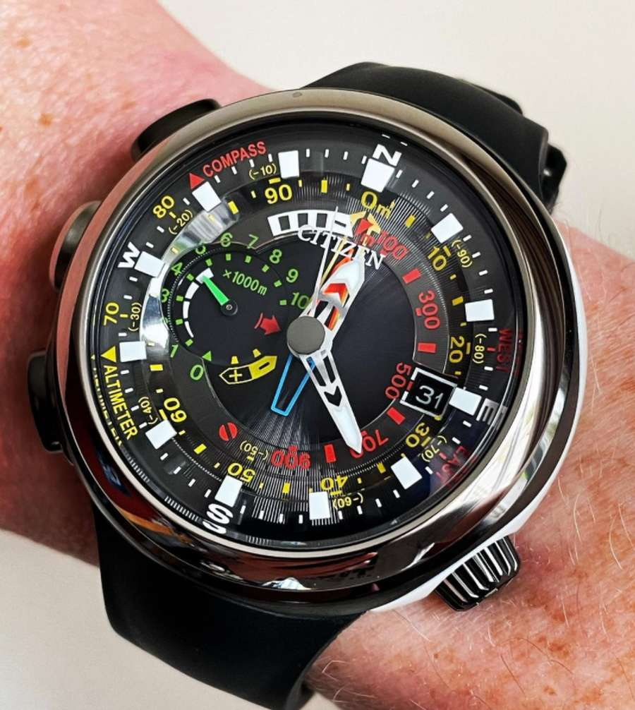 A picture containing person, watch, indoor, black  Description automatically generated