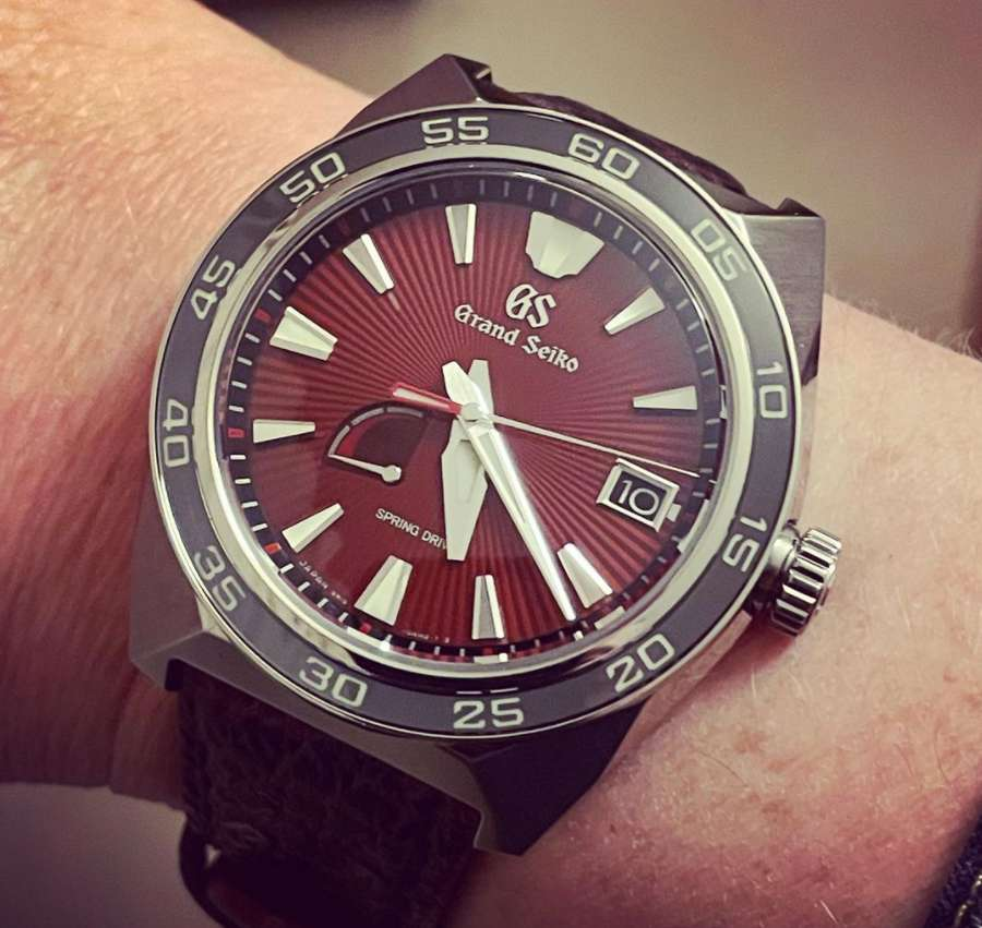 A picture containing watch, hand, close  Description automatically generated