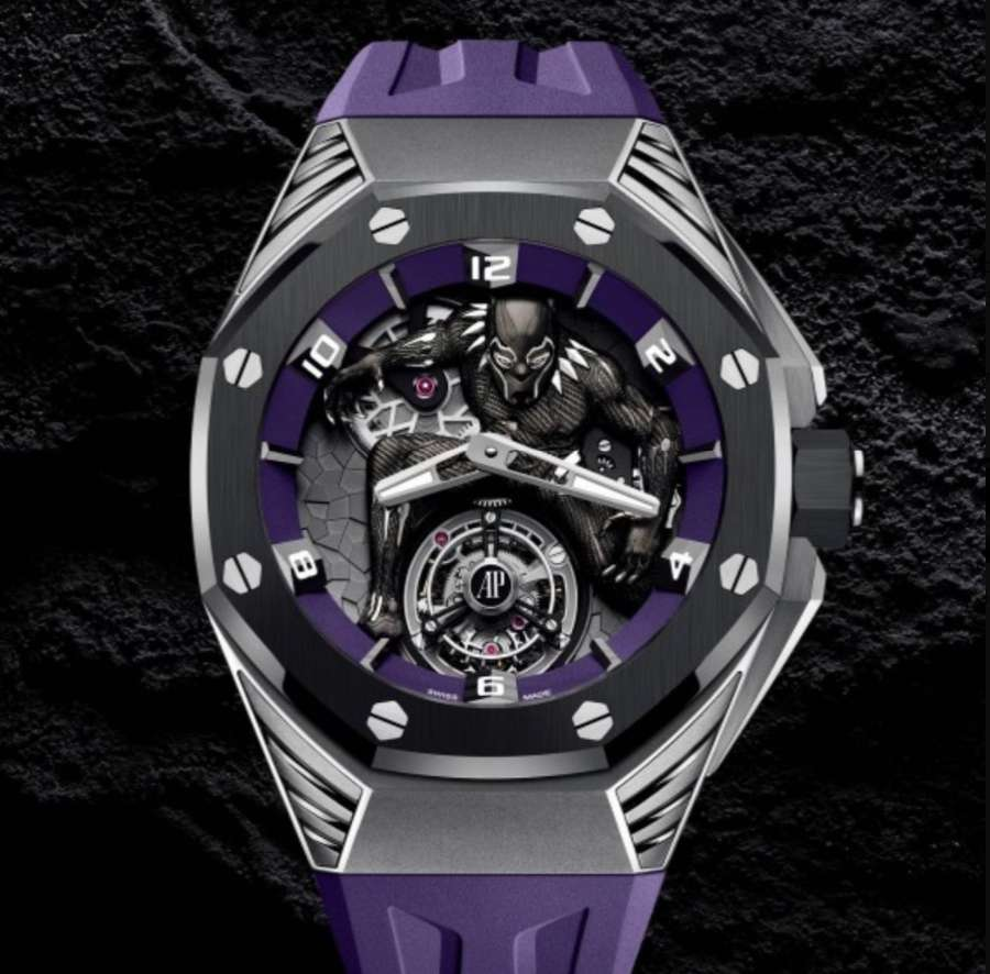 A picture containing watch, purple, chain  Description automatically generated