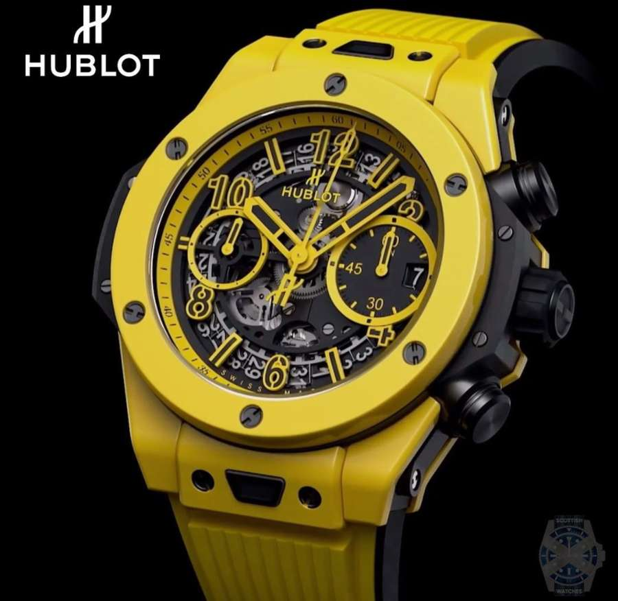 A picture containing watch, yellow  Description automatically generated