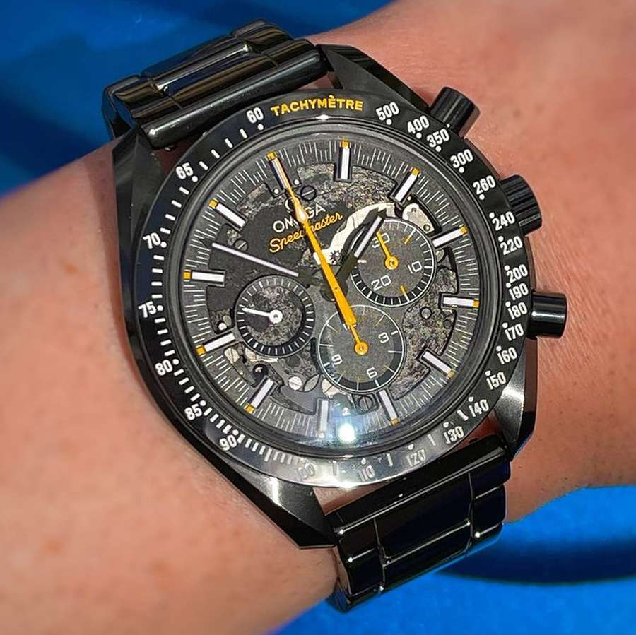 A person's hand holding a watch Description automatically generated with low confidence