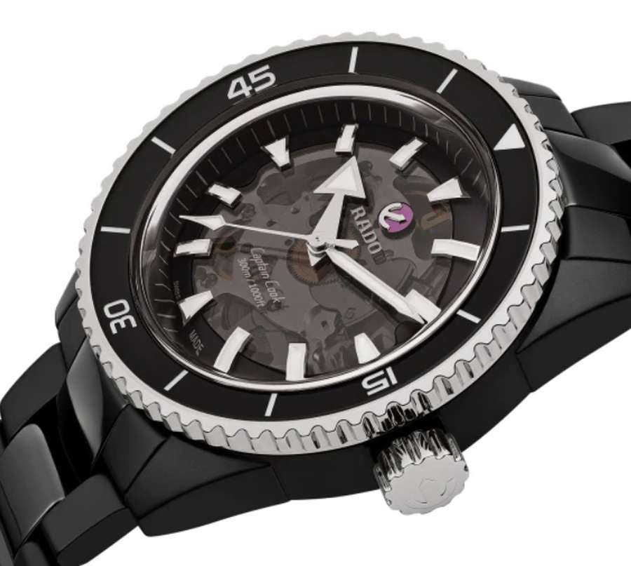 A picture containing watch, black, white Description automatically generated