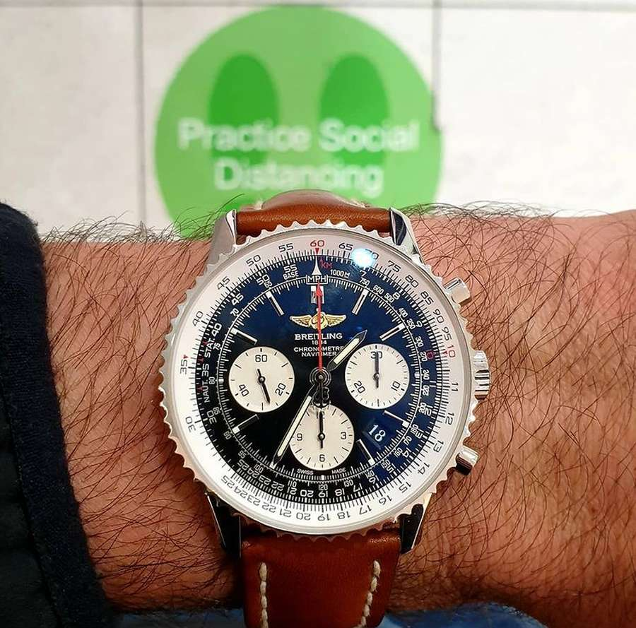 A watch on a person's wrist Description automatically generated
