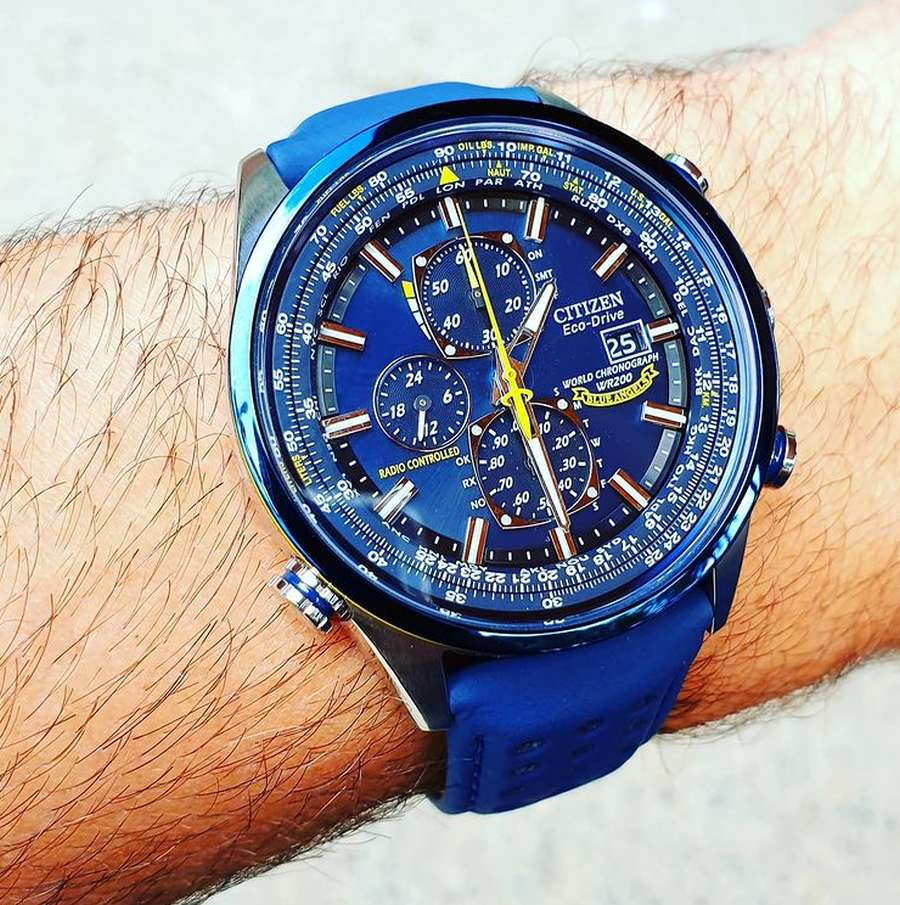 A blue watch on a person's wrist Description automatically generated with medium confidence