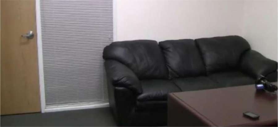 A couch in a room  Description automatically generated with medium confidence