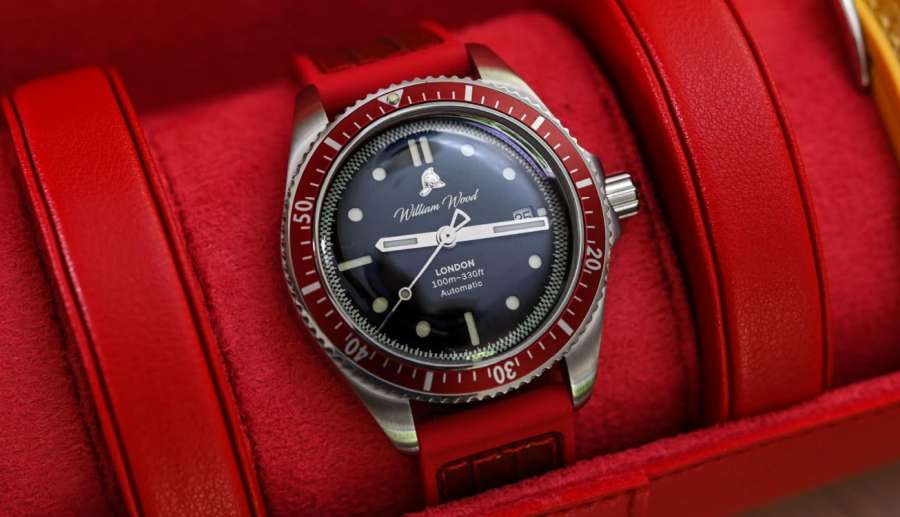 A watch on a red leather surface  Description automatically generated with low confidence