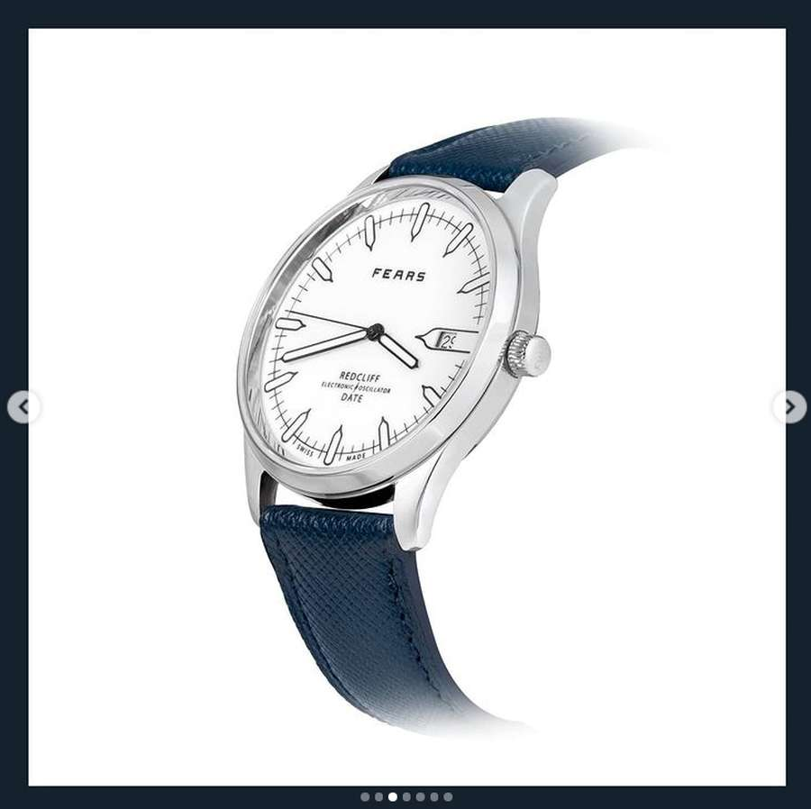 A picture containing text, clock, watch, time  Description automatically generated