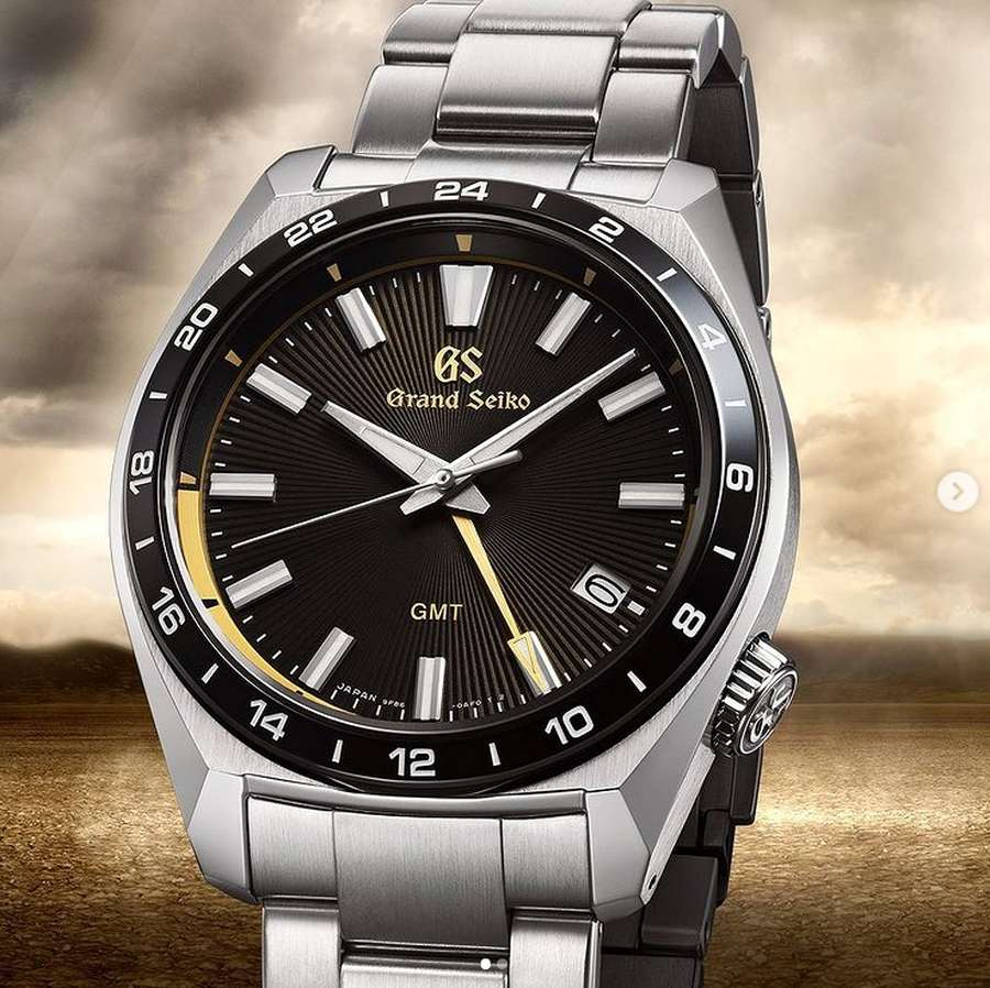A picture containing watch, floor, black  Description automatically generated