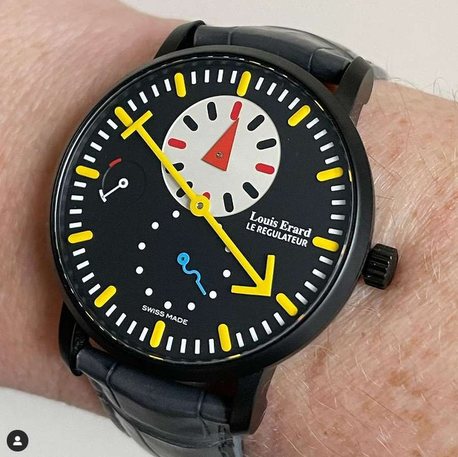 A picture containing watch, indoor, person, black Description automatically generated