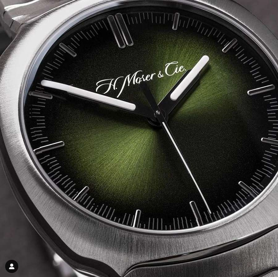 A close up of a watch Description automatically generated with low confidence