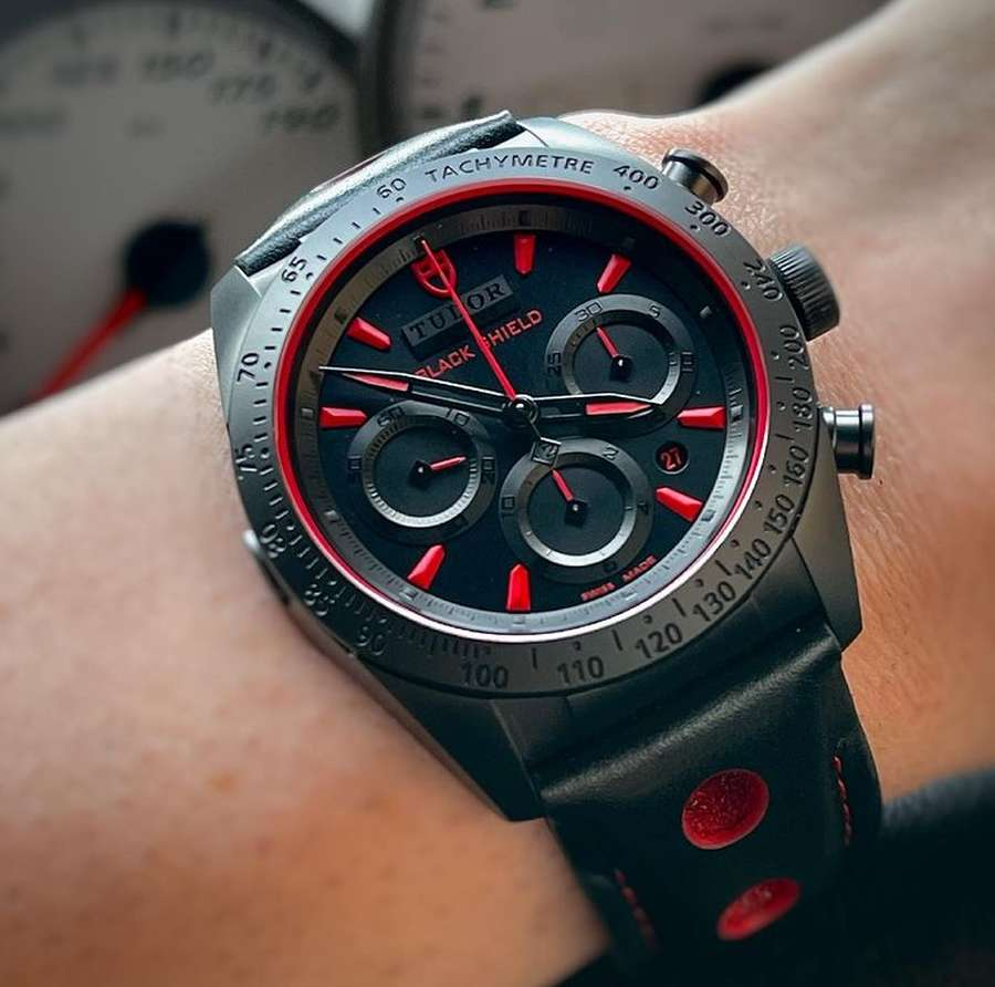 A picture containing watch, person Description automatically generated