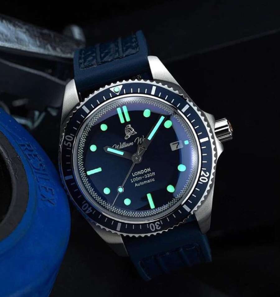 A picture containing watch, indoor, blue Description automatically generated