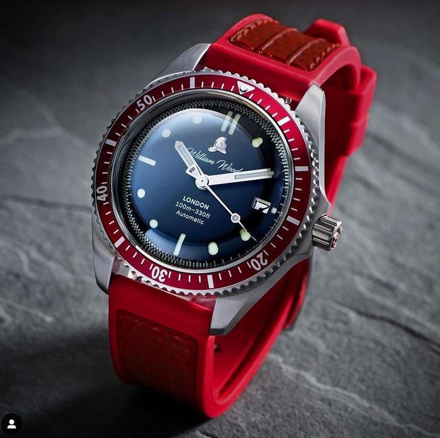 A picture containing red, watch, indoor Description automatically generated
