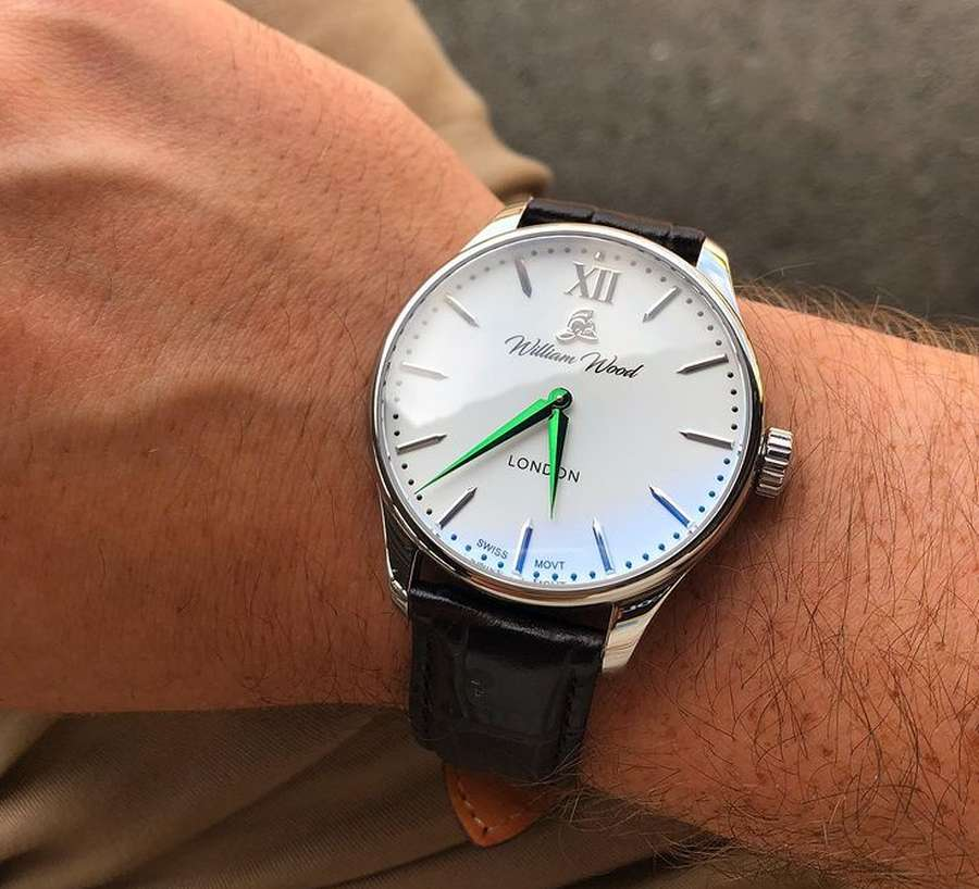 A person wearing a watch Description automatically generated with low confidence