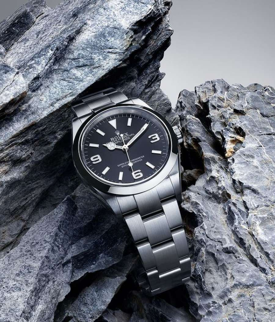 A black watch on a rock Description automatically generated with low confidence