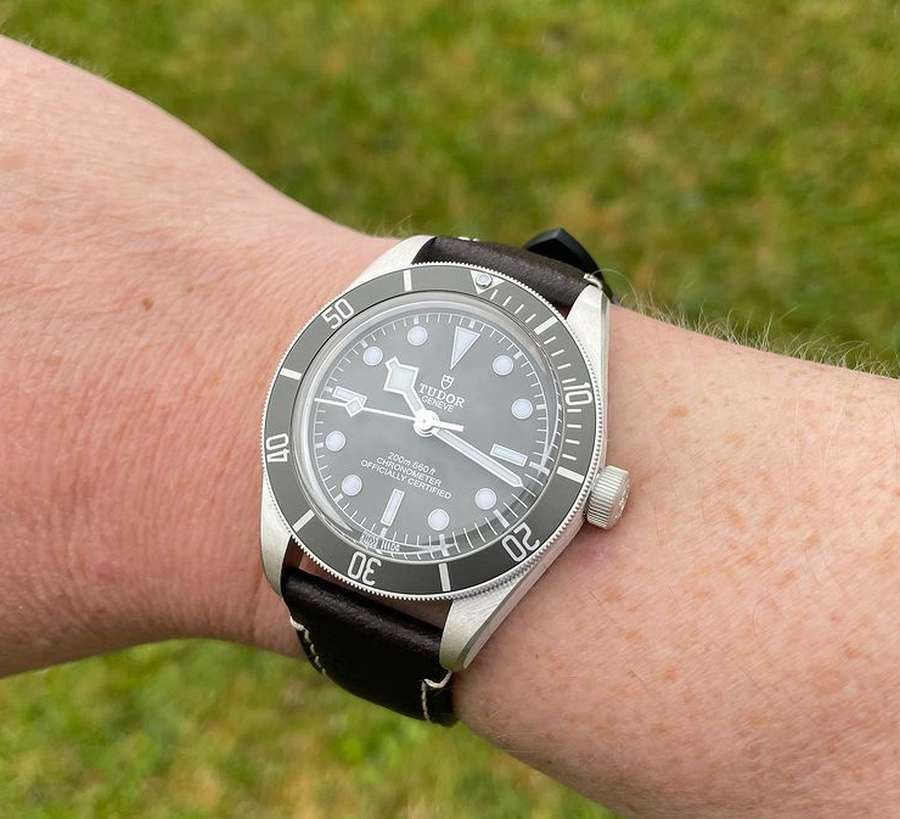 A person's wrist wearing a watch Description automatically generated with low confidence