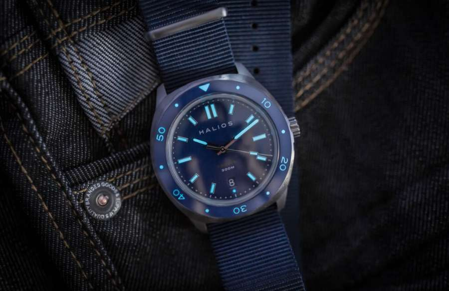 A watch on a leather jacket Description automatically generated with low confidence