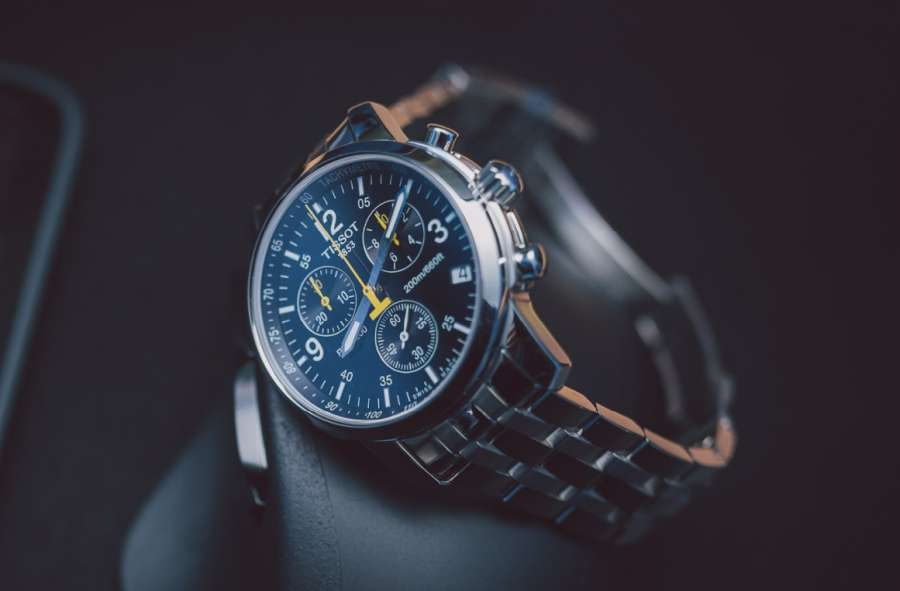A picture containing watch, indoor, chain Description automatically generated
