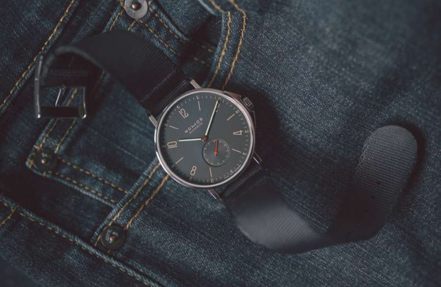 A picture containing watch, feet, leather Description automatically generated