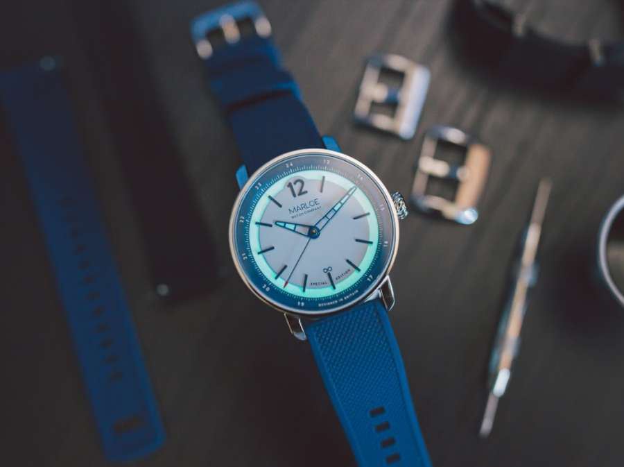 A picture containing indoor, watch, blue Description automatically generated