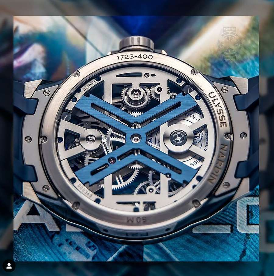 A picture containing text, watch, blue Description automatically generated