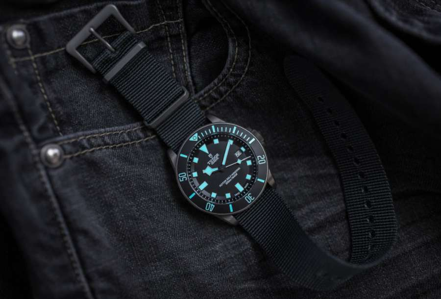 A watch on a person's jacket Description automatically generated with medium confidence