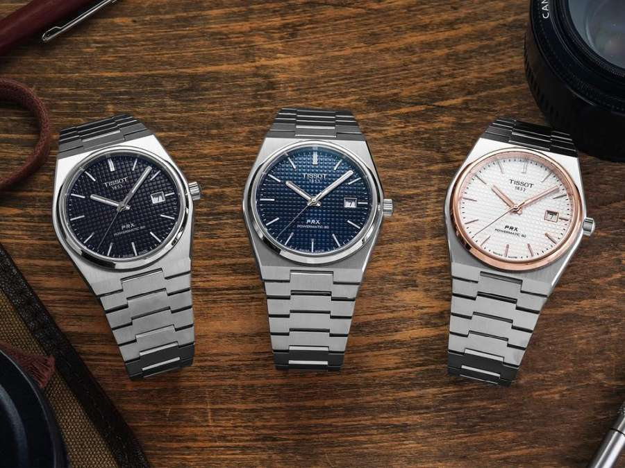A group of watches on a table Description automatically generated with medium confidence