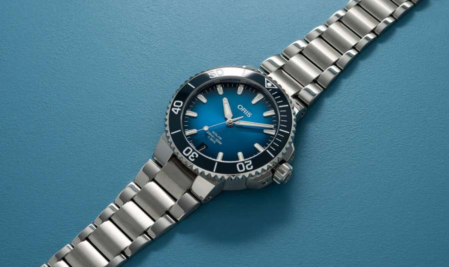 A picture containing watch, blue, chain Description automatically generated