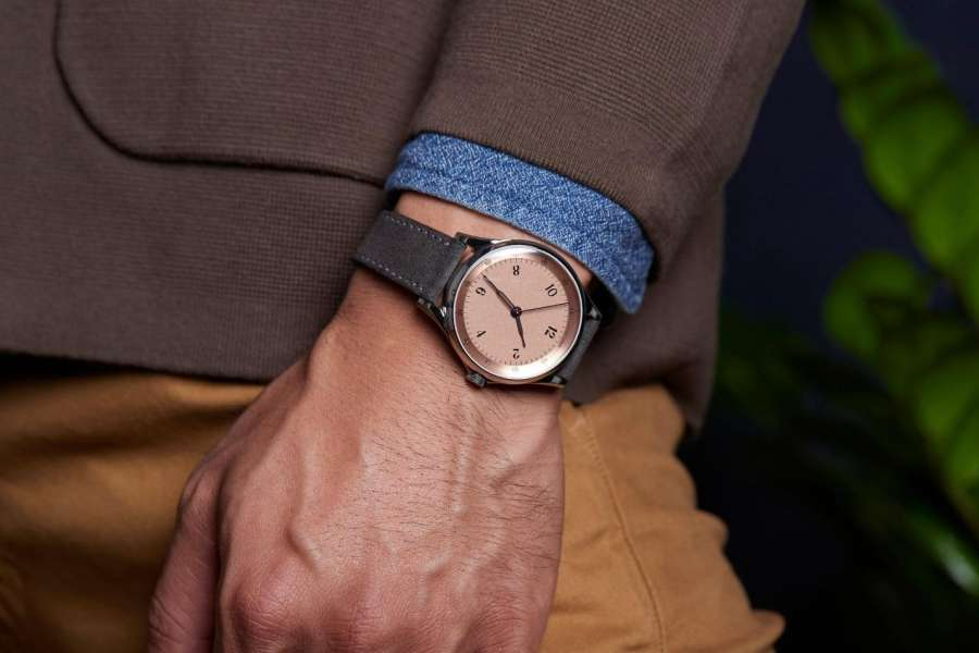 A watch on a person's wrist Description automatically generated with medium confidence