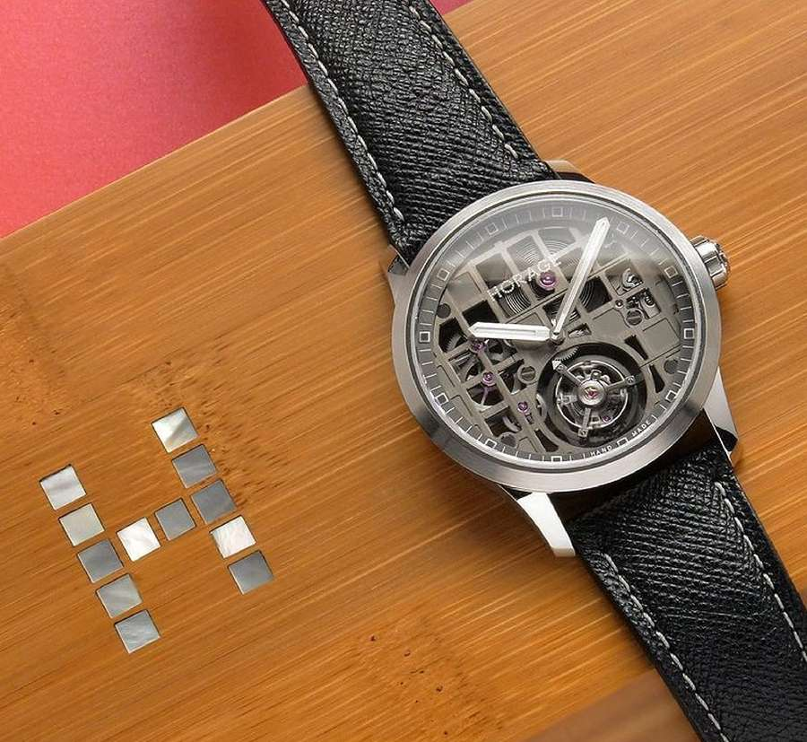 A watch on a table Description automatically generated with medium confidence