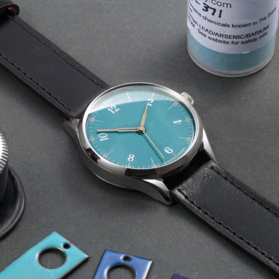 A watch on a table Description automatically generated with low confidence