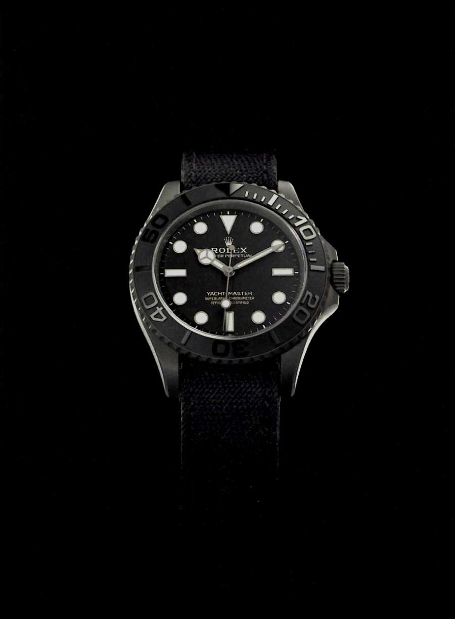 A picture containing watch, dark Description automatically generated