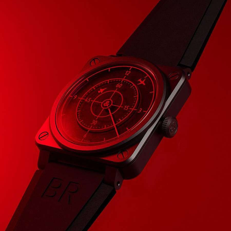 A red wrist watch Description automatically generated with low confidence